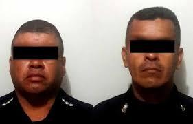 dos policías condenados